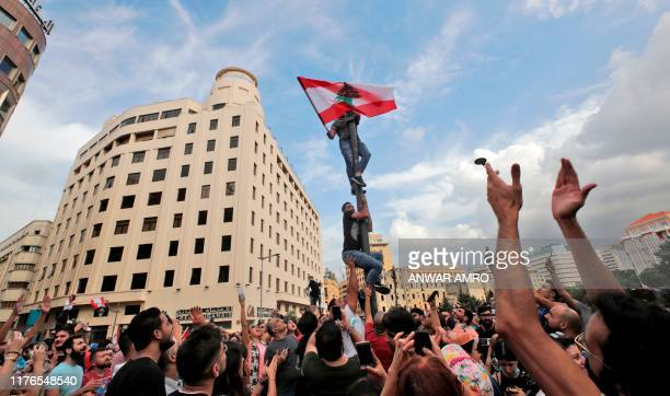 TOPSHOT Lebanese demonstrators gather during a mass protest in the centre of the capital Beirut on October 18 2019 against dire economic conditions...