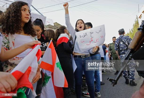 Lebanese demonstrators gather during an antigovernment protest in the northern Lebanese town of Amioun near the port city of Tripoli on November 8...