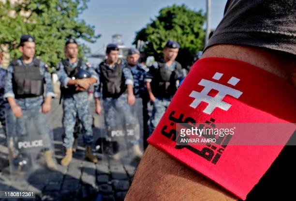 Lebanese demonstrators gather outside the Port of Beirut during ongoing anti-government protests, in the capital Beirut on November 8, 2019. - An...