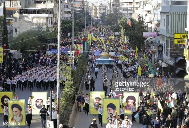 Lebanese demonstrators march with their national flags and Palestinian flags and banners of the militant Shiite movement Hezbollah during a protest...
