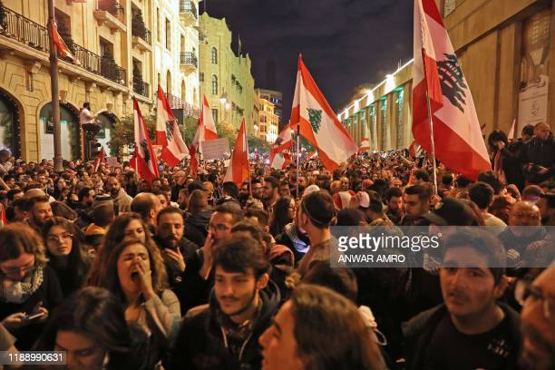 Lebanese demonstrators south slogans in the capital Beirut on December 15, 2019. - Lebanese police clashed with anti-government protesters in Beirut...
