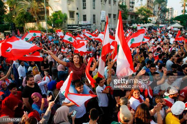 Lebanese demonstrators take part in a protest against dire economic conditions in Lebanon's southern city of Sidon on October 21 2019 Thousands...
