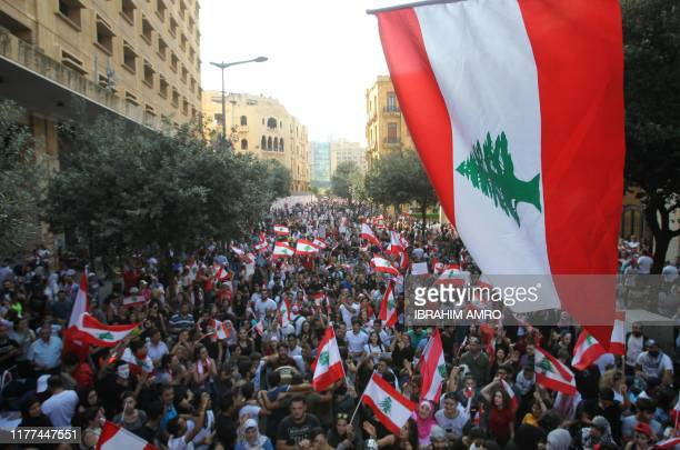 TOPSHOT Lebanese demonstrators take part in a protest against dire economic conditions in Lebanon's southern city of Sidon on October 21 2019...
