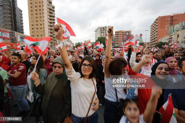 TOPSHOT Lebanese demonstrators take to the streets in continuing protests against the government in the northern Lebanese port city of Tripoli on...