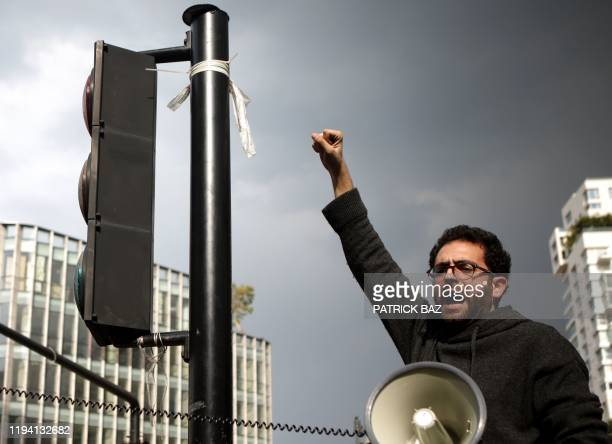 Lebanese deomonstrator shouts slogans during a protest in the capital Beirut's downtown district to protest against a political elite accused of...
