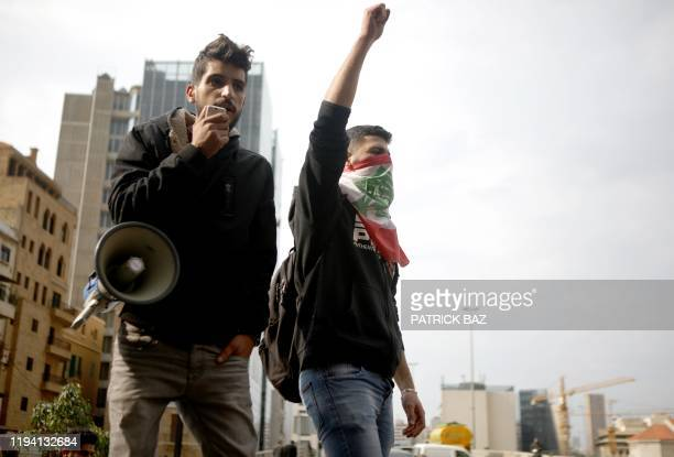 Lebanese deomonstrators shout slogans during a protest in the capital Beirut's downtown district to protest against a political elite accused of...