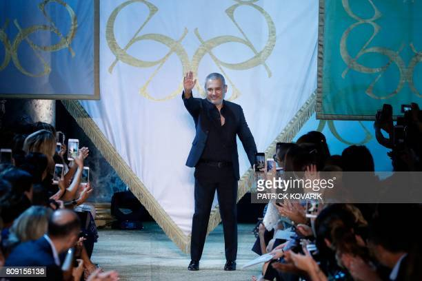 Lebanese designer Elie Saab acknowledges the audience at the end of the 20172018 fall/winter Haute Couture collection in Paris on July 5 2017 / AFP...
