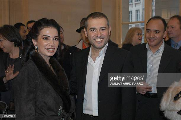 Lebanese designer Elie Saab is greeted by Nazek Hariri the wife of Lebanon's Prime Minister Rafiq Hariri at the end of his show during the...