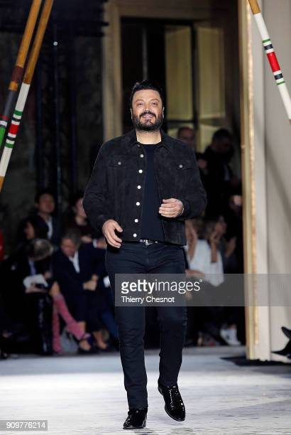 Lebanese designer Zuhair Murad acknowledges the audience at the end of the Zuhair Murad Spring Summer 2018 show as part of Paris Fashion Week on...