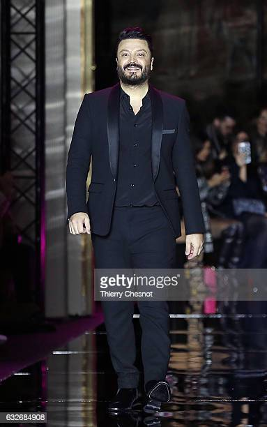 Lebanese designer Zuhair Murad walks the runway after the Zuhair Murad Spring Summer 2017 show as part of Paris Fashion Week on January 25 2017 in...
