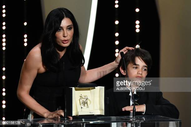 TOPSHOT Lebanese director and actress Nadine Labaki delivers a speech on stage next to Syrian actor Zain alRafeea after she was awarded with the Jury...