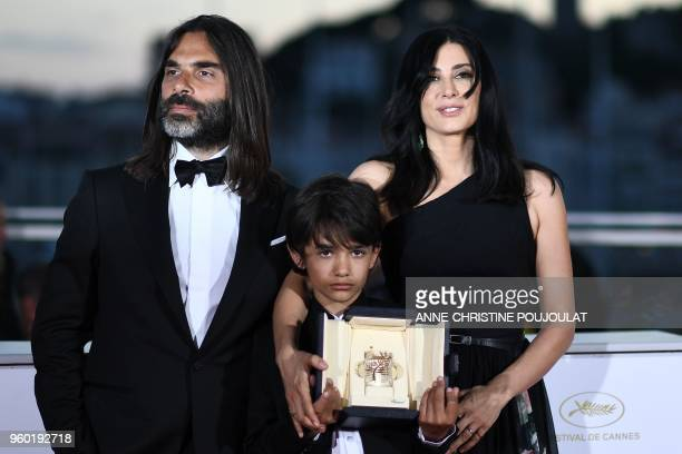 TOPSHOT Lebanese director and actress Nadine Labaki her husband Lebanese producer Khaled Mouzanar and Syrian actor Zain alRafeea pose with the trophy...