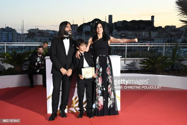 Lebanese director and actress Nadine Labaki her husband Lebanese producer Khaled Mouzanar and Syrian actor Zain alRafeea pose with the trophy on May...