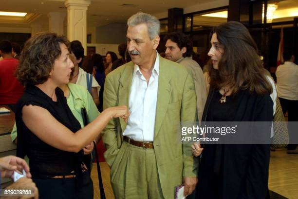 Lebanese director Randa elChahal speaks to Jean Chamoun and May Masri prior to the opening of the fourth editition of Beirut Film Festival at Unesco...