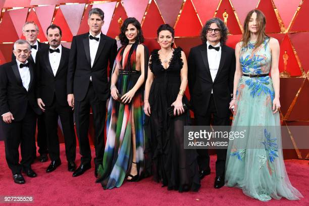 Lebanese director Ziad Doueiri poses with cast members as they arrive for the 90th Annual Academy Awards on March 4 in Hollywood California / AFP...