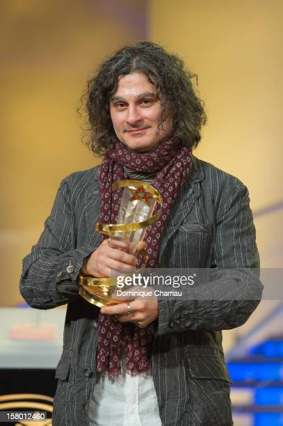 """Lebanese director Ziad Doueiri poses with the Golden Star award he received for the film """"The Attack"""" during the award ceremony of the 12th..."""
