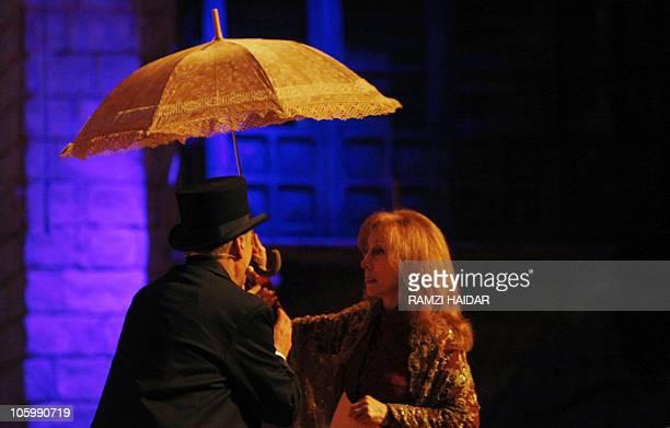 Lebanese diva Fairuz sings with veteran singer Elie Shueiri in 'Sah elNom' in the Gulf emirate of Sharjah on May 2 2008 Fairuz took her popular 1971...