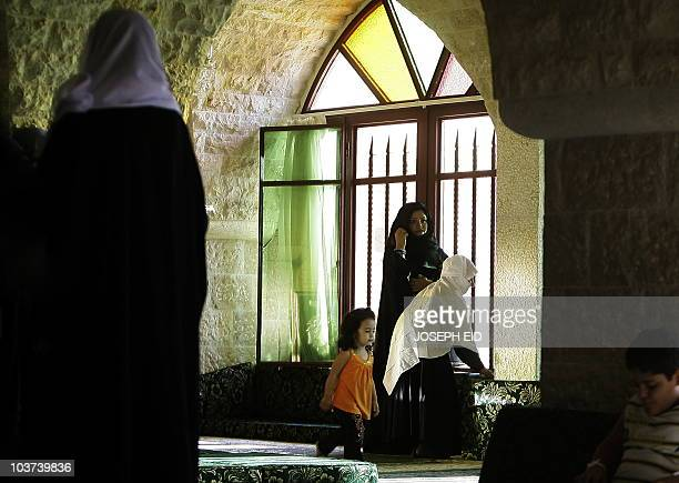 Lebanese Druze family visits the shrine of revered Druze cleric Abu Hassan Aref Halawe in the village of Baruk in the Lebanese mountains southeast of...