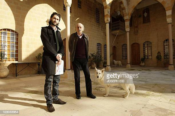 Lebanese Druze leader Walid Jumblatt stands with his eldest son Taymur in the courtyard of their ancestral home in Mukhtara in Lebanon's Shouf...