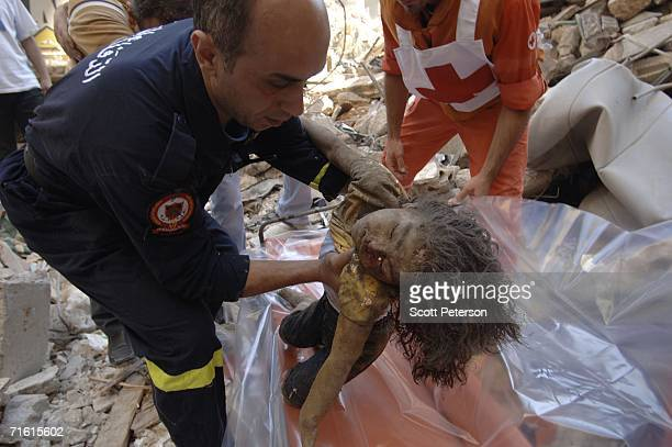 Lebanese emergency workers retrieve the body of fouryearold Riham Ramaiti from rubble two days after an Israeli airstrike collapsed three buildings...