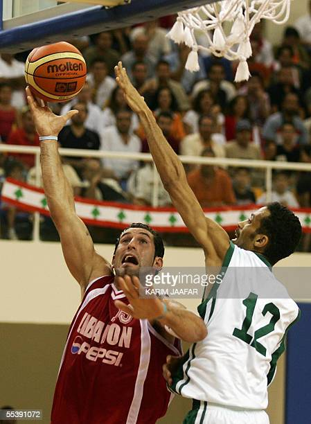 Lebanese Fadi al-Khatib vies with Ahmad Samater of Saudia Arabia during their national teams Asian Basketball Championship match 12 September 2005 at...