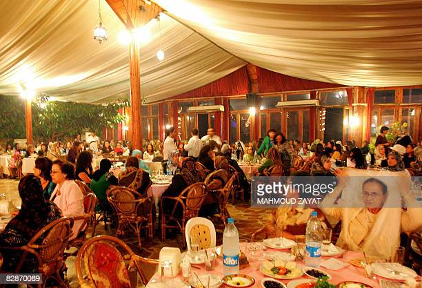 SIQLAWI Lebanese families eat an early breakfast 'Suhur' meal before the day's fast in a huge tent erected at a restaurant in the southern city of...