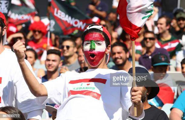 Lebanese fan celebrates a try during the 2017 Rugby League World Cup match between France and Lebanon at Canberra Stadium on October 29 2017 in...