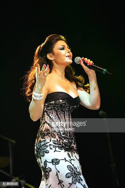 Lebanese fashion ans singing star Haifa Wehbe performs late on July 8 2008 during an exclusive Sea of Stars gala dinner at a fivestar beach hotel in...