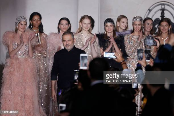 Lebanese fashion designer Elie Saab acknowledges the audience at the end of the 2018 spring/summer Haute Couture collection fashion show on January...