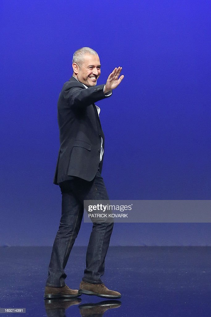 Lebanese fashion designer Elie Saab acknowledges the public during his Fall/Winter 2013-2014 ready-to-wear collection show, on March 6, 2013 in Paris.