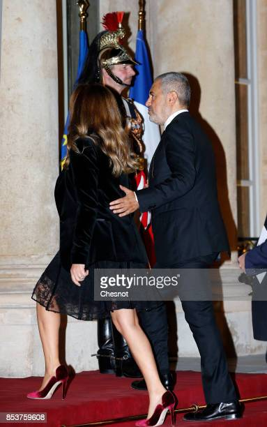 Lebanese fashion designer Elise Saab and his wife arrive for a state dinner with Lebanese President Michel Aoun and French President Emmanuel Macron...