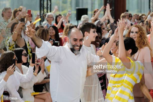 Lebanese fashion designer Rabih Kayrouz acknowledges the audience as he celebrates with models at the end of the Maison Rabih Kayrouz Women's...