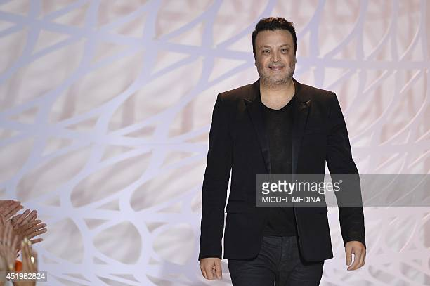 Lebanese fashion designer Zuhair Murad acknowledges the public at the end of his 2014/2015 Haute Couture FallWinter collection fashion show on July...