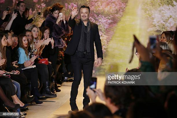 Lebanese fashion designer Zuhair Murad acknowleges the public at the end of his Haute Couture SpringSummer 2014 collection show on January 23 2014 in...