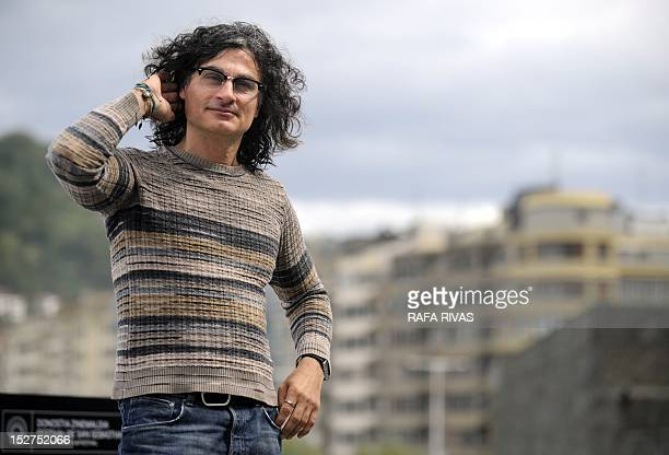 Lebanese film director Ziad Doueiri poses during a photocall after the screening of his film 'The Attack' during the 60th San Sebastian International...