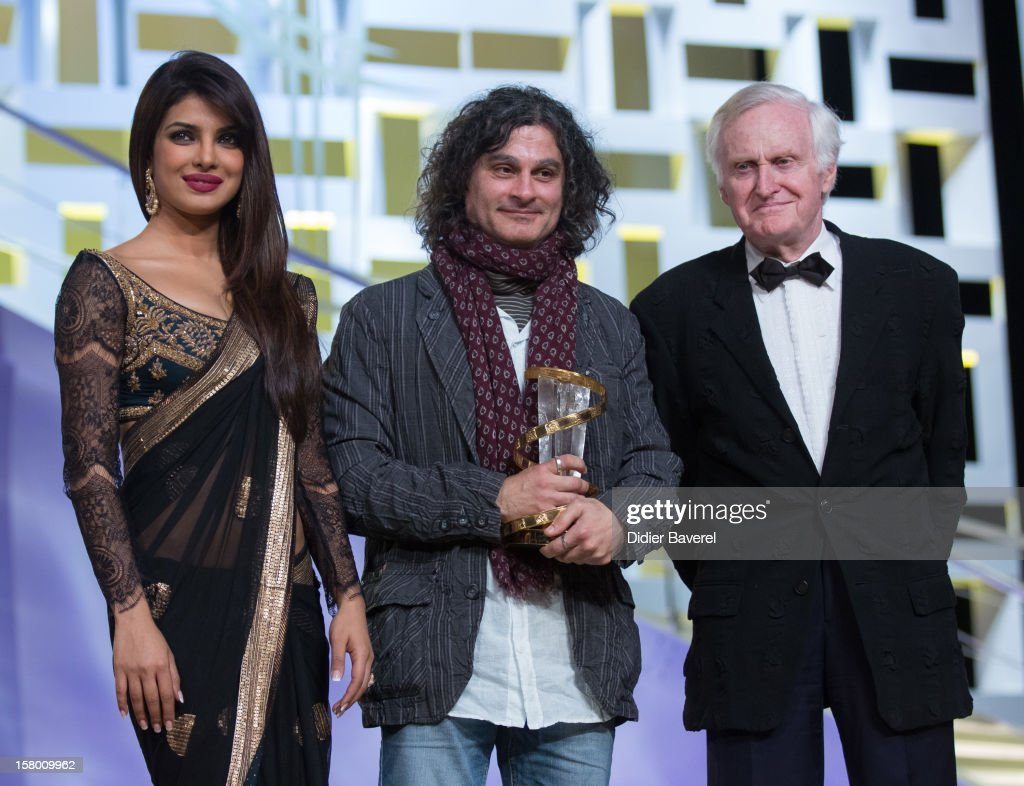 Lebanese Film director Ziad Doueiri wins the Golden Star award for his movie 'The Attack' and poses with Indian actress and singer Priyanka Chopra and British film director, jury president, John Boorman at 12th International Marrakech Film Festival on December 8, 2012 in Marrakech, Morocco.