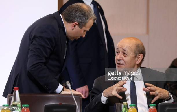 Lebanese Foreign Affairs Minister Gebran Bassil gestures as he speaks with French Foreign Affairs Minister JeanYves Le Drian as they take part in the...