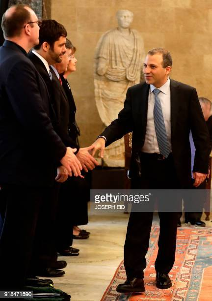 Lebanese Foreign Minister Gebran Bassil shakes hands with member of the US delegation prior to a meeting with the US Secretary of State at the...