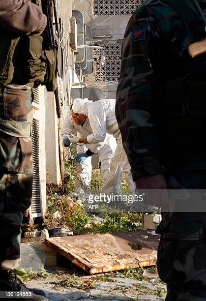 Lebanese forensic detectives inspect the restaurant which was rocked by an explosion early December 28 2011 in the southern Lebanese city of Tyre AFP...