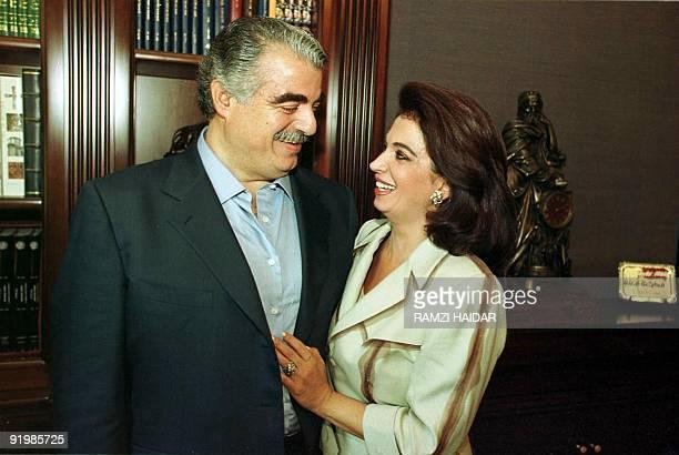 Lebanese former and likely next Prime Minister Rafiq Hariri hugs his wife Nazek at their home in Beirut 07 September 2000