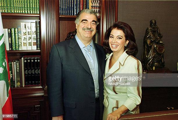 Lebanese former and likely next Prime Minister Rafiq Hariri poses with his wife Nazek at their home in Beirut 07 September 2000