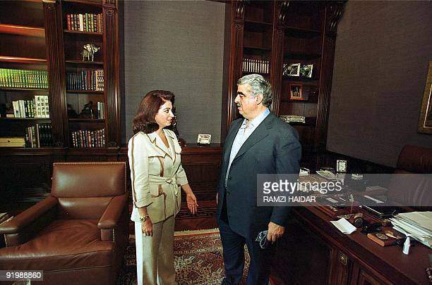 Lebanese former and likely next Prime Minister Rafiq Hariri talks to his wife Nazeq at their home in Beirut 07 September 2000