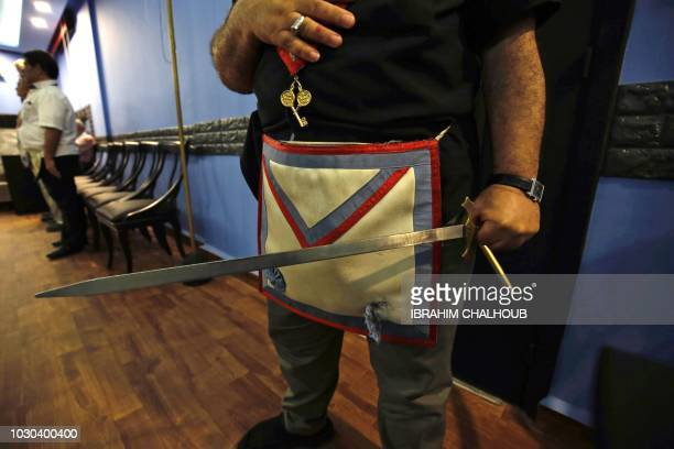 A Lebanese Freemason holds a sword at the Grand Orient of Lebanon in the northern city of Tripoli on June 26 2018