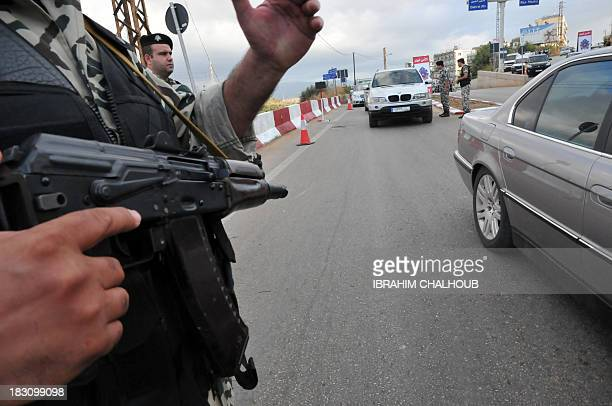 Lebanese general security forces man a checkpoint at the southeastern entrance of Tripoli as part of a security plan on October 4 2013 AFP...