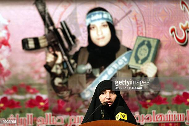 lebanese Ghada Musawi from Hezbollah group talks 27 January 2004 during a memorial service for Palestinian suicide bomber Reem Saleh AlRiyashi in the...