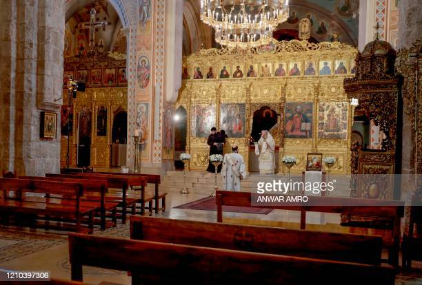 Lebanese Greek Orthodox Archbishop for the Archdiocese of Beirut Metropolitan Elias Audi holds a crowdless Easter service due to the COVID19 pandemic...