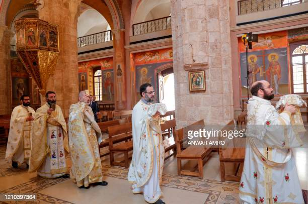 Lebanese Greek Orthodox priests hold a crowdless Easter service due to the COVID19 pandemic at the Saint George Church at Nejmeh square in downtown...