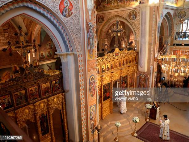 Lebanese Greek Orthodox priests prepare for a crowdless Easter service due to the COVID19 pandemic at the Saint George Church at Nejmeh square in...
