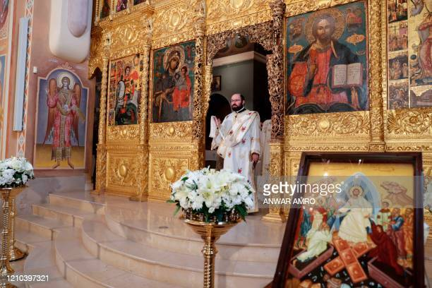 Lebanese Greek Orthodox priests start a crowdless Easter service due to the COVID19 pandemic at the Saint George Church at Nejmeh square in downtown...