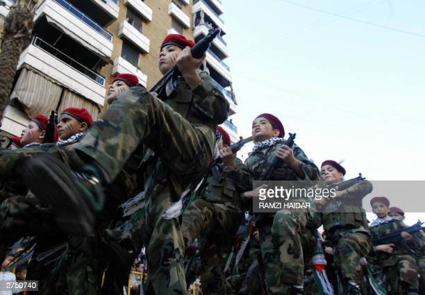 Lebanese Hezbollah boy scouts holding plastic guns parade in the streets of the southern suburbs of Beirut to mark Jerusalem Day 21 November 2003 The...